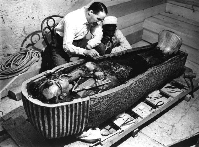 The explorer Howard Carter working on the inner coffin of Tutankhamun.